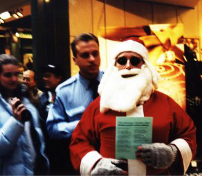 Santa Claus is escorted out of a mall by security